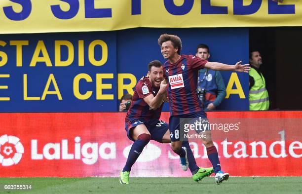 Sergi Enrich and Takashi Inui of SD Eibar celebrates their goal during their La Liga match between Villarreal CF and SD Eibar at the Estadio de La...
