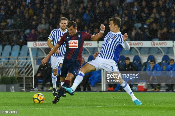 Sergi Enrich of Eibar duels for the ball with Diego Llorente of Real Sociedad during the Spanish league football match between Real Sociedad and...