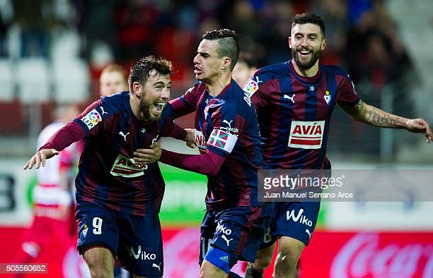 Sergi Enrich of SD Eibar celebrates with his teammates Daniel Garcia SD Eibar after scoring his team's third goal during the La Liga match between SD...