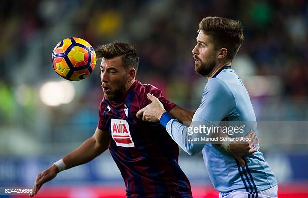 Sergi Enrich of SD Eibar duels for the ball with Andreu Fontas of RC Celta de Vigo during the La Liga match between SD Eibar and RC Celta de Vigo at...