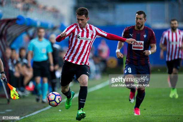 Sergi Enrich of SD Eibar duels for the ball with Aymeric Laporte of Athletic Club during the La Liga match between SD Eibar and Athletic Club at...