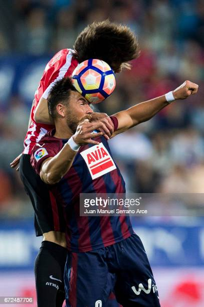 Sergi Enrich of SD Eibar duels for the ball with Benat Etxebarria of Athletic Club during the La Liga match between SD Eibar and Athletic Club at...