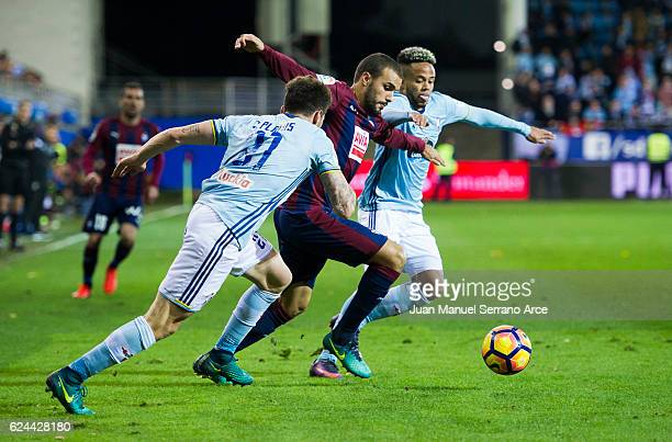 Sergi Enrich of SD Eibar duels for the ball with Carles Planas and Theo Bongonda of RC Celta de Vigo during the La Liga match between SD Eibar and RC...