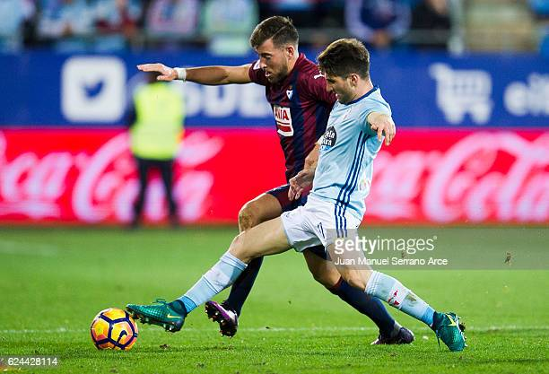 Sergi Enrich of SD Eibar duels for the ball with Carles Planas of RC Celta de Vigo during the La Liga match between SD Eibar and RC Celta de Vigo at...
