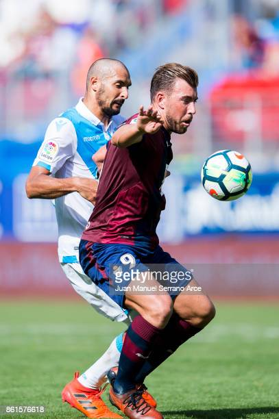 Sergi Enrich of SD Eibar duels for the ball with Celso borges of RC Deportivo La Coruna during the La Liga match between SD Eibar and RC Deportivo La...