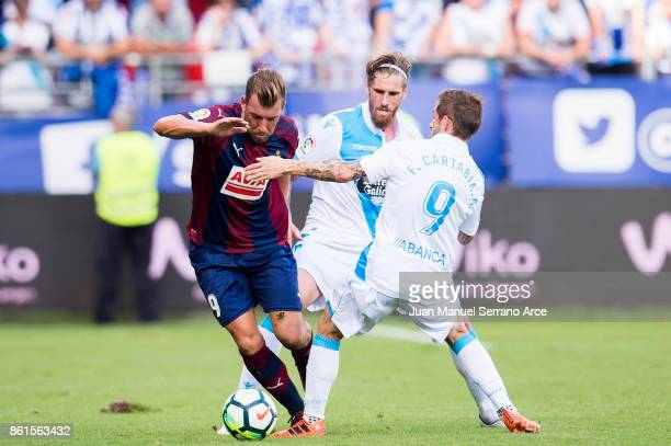 Sergi Enrich of SD Eibar duels for the ball with Fede Cartabia of RC Deportivo La Coruna during the La Liga match between SD Eibar and RC Deportivo...