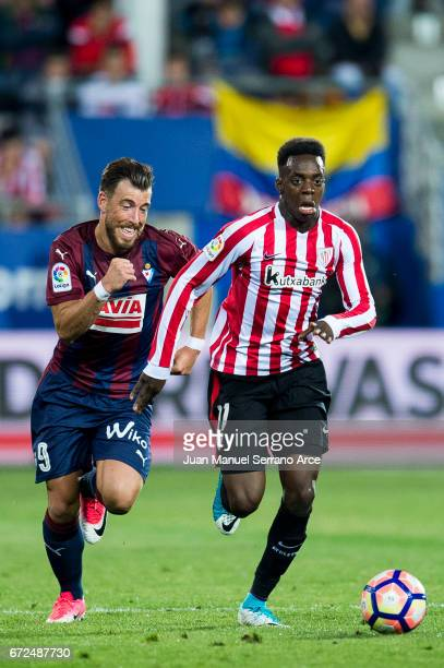Sergi Enrich of SD Eibar duels for the ball with Inaki Willams of Athletic Club during the La Liga match between SD Eibar and Athletic Club at Ipurua...