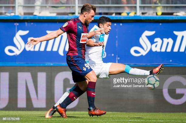 Sergi Enrich of SD Eibar duels for the ball with Sidnei Rechel da Silva of RC Deportivo La Coruna during the La Liga match between SD Eibar and RC...