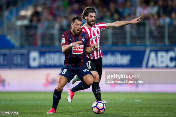 Sergi Enrich of SD Eibar duels for the ball with Yerran Alvarez of Athletic Club during the La Liga match between SD Eibar and Athletic Club at...
