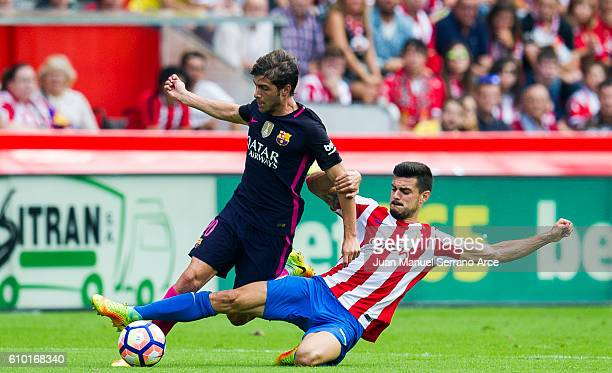 Sergi Roberto Carnicer of FC Barcelona duels for the ball with Sergio Alvarez of Real Sporting de Gijon during the La Liga match between Real...