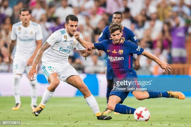 MADRID SPAIN AUGUST 16 Sergi Roberto Carnicer of FC Barcelona fights for the ball with Daniel Ceballos Fernandez Dani Ceballos of Real Madrid during...