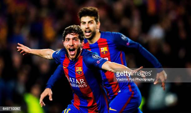 Sergi Roberto of Barcelona celebrates with his team mate Gerard Pique after scoring his team's six and final goal during the UEFA Champions League...