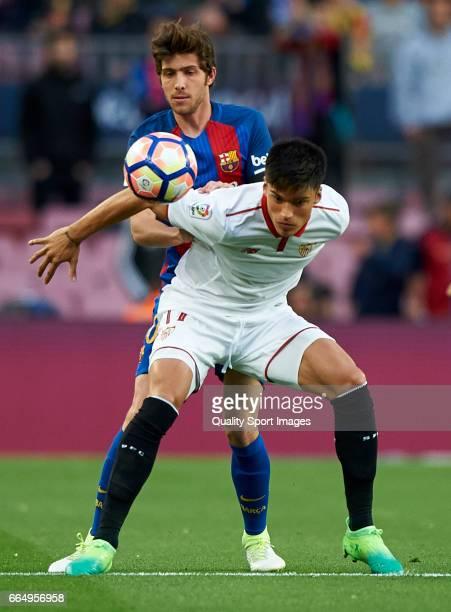 Sergi Roberto of Barcelona competes for the ball with Joaquin Correa of Sevilla during the La Liga match between FC Barcelona and Sevilla FC at Camp...