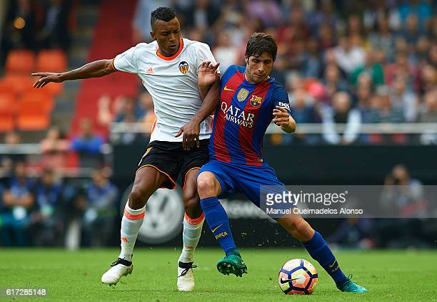 Sergi Roberto of Barcelona competes for the ball with Nani of Valencia during the La Liga match between Valencia CF and FC Barcelona at Mestalla...
