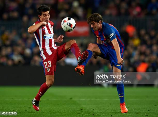 Sergi Roberto of Barcelona competes for the ball with Nico Gaitan of Atletico de Madrid during the Copa del Rey semifinal second leg match between FC...
