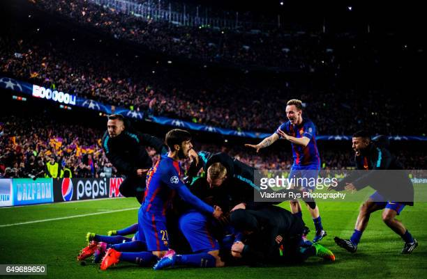 Sergi Roberto of Barcelona is celebrated by his team mates after scoring his team's six and final goal during the UEFA Champions League Round of 16...
