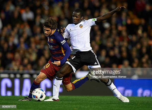Sergi Roberto of Barcelona is tackled by Ibrahim Diallo of Valencia during the Copa del Rey Semi Final second leg match between Valencia CF and FC...