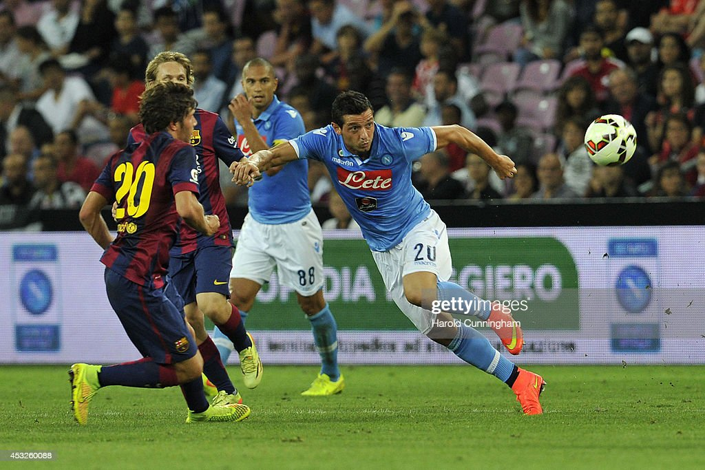 Sergi Roberto (L) of FC Barcelona and Blerim Dzemaili of SSC Napoli (R) in action during the pre-season friendly match between FC Barcelona and SSC Napoli on August 6, 2014 in Geneva, Switzerland.