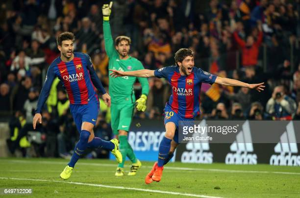 Sergi Roberto of FC Barcelona celebrates his winning goal for Barca with Gerard Pique while goalkeeper of PSG Kevin Trapp gestures during the UEFA...