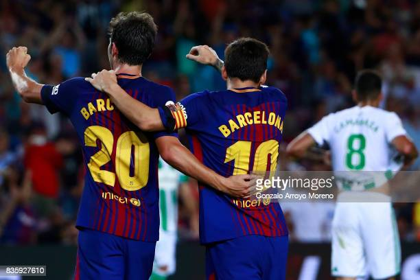 Sergi Roberto of FC Barcelona celebrates scoring their second goal with teammate Lionel Messi during the La Liga match between FC Barcelona and Real...
