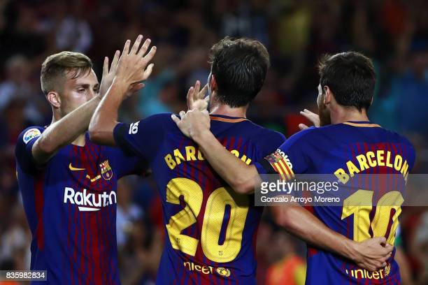 Sergi Roberto of FC Barcelona celebrates scoring their second goal with teammates Lionel Messi and Gerard Deulofeu during the La Liga match between...