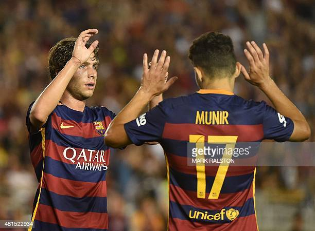 Sergi Roberto of FC Barcelona celebrates with teammate Munir El Haddadi after scoring against the Los Angeles Galaxy during their International...