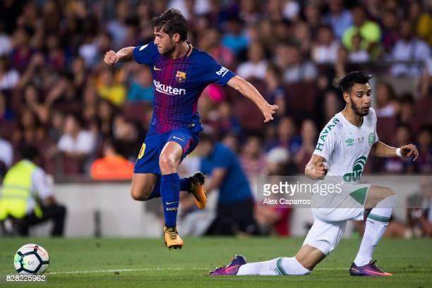 Sergi Roberto of FC Barcelona dribbles Emilio Zeballos of Chapecoense during the Joan Gamper Trophy match between FC Barcelona and Chapecoense at...