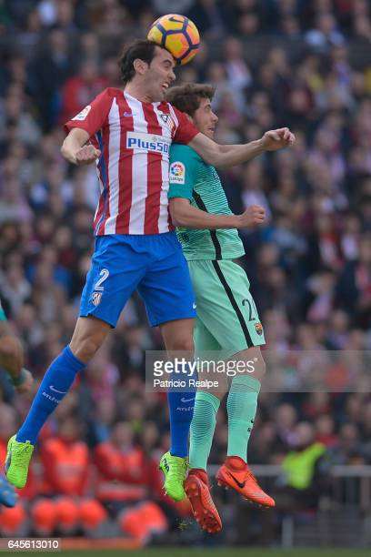 Sergi Roberto of FC Barcelona fights for the ball with Diego Godin of Atletico de Madrid during the La Liga match between Atletico Madrid and FC...