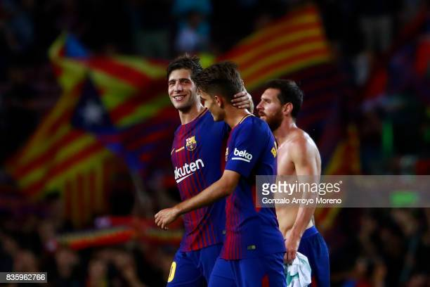 Sergi Roberto of FC Barcelona leaves the pithc with teammates Denis Suarez and Lionel Messi after the La Liga match between FC Barcelona and Real...