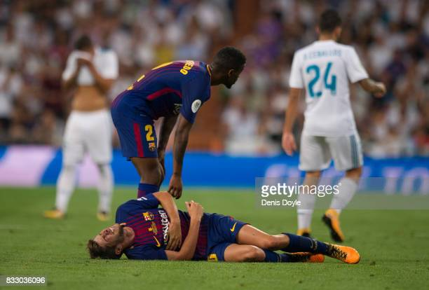 Sergi Roberto of FC Barcelona lies winded after crashing into Henrique Casemiro of Real Madrid CF during the Supercopa de Espana Final 2nd Leg match...