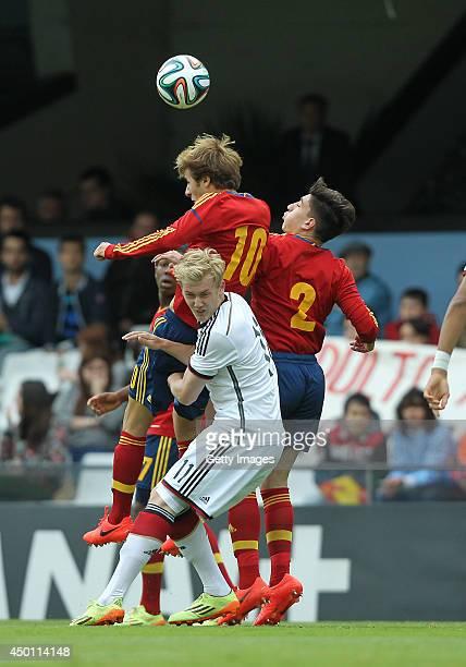 Sergi Samper and Hector Bellerin of Spain challenge Julian Brandt of Germany during the UEFA Under 19 Elite Round match between U19 Spain and U19...