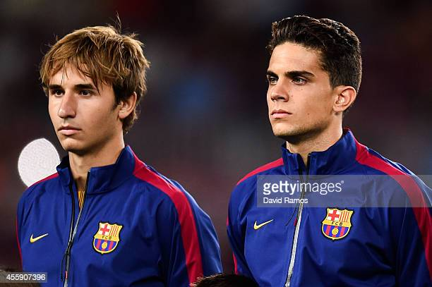Sergi Samper and Marc Bartra of FC Barcelona look on prior to the UEFA Champions League Group F match between FC Barcelona and APOEL FC at the Camp...