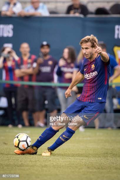 Sergi Samper of Barcelona passes the ball during the International Champions Cup match between FC Barcelona and Juventus at the MetLife Stadium on...