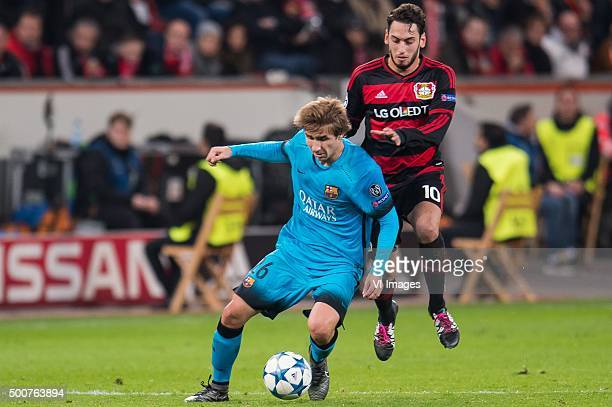 Sergi Samper of FC Barcelona Hakan Calhanoglu of Bayer 04 Leverkusen during the UEFA Champions League match between Bayer 04 Leverkusen and FC...