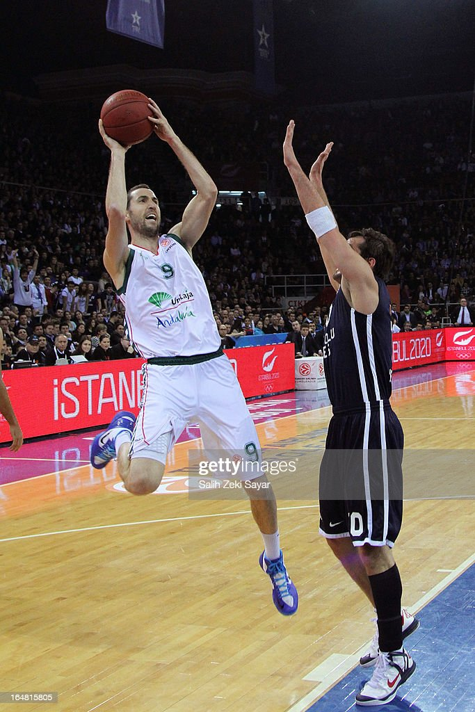 Sergi Vidal #9 of Unicaja Malaga competes with Kerem Tunceri #10 of Anadolu Efes during the 2012-2013 Turkish Airlines Euroleague Top 16 Date 13 between Anadolu EFES Istanbul v Unicaja Malaga at Abdi Ipekci Sports Arena on March 28, 2013 in Istanbul, Turkey.