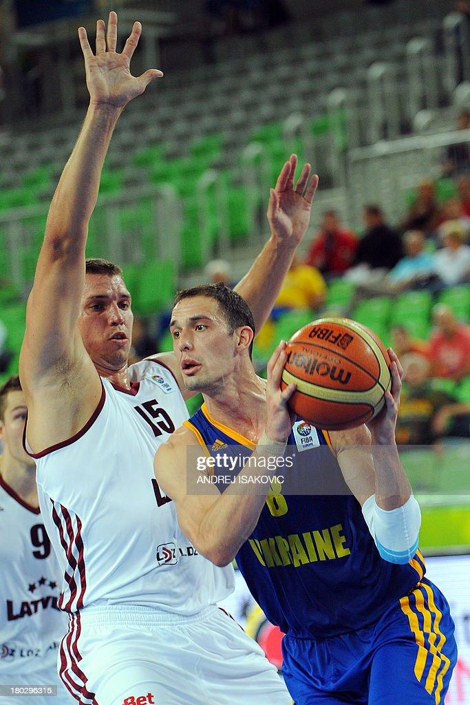 Sergii Gladyr of Ukraine (R) vies with Andrejs Selakovs of Latvia during the FIBA EuroBasket second round Group E basketball championship qualification match between Latvia and Ukraine, in Ljubljana, Slovenia, on September 11, 2013.