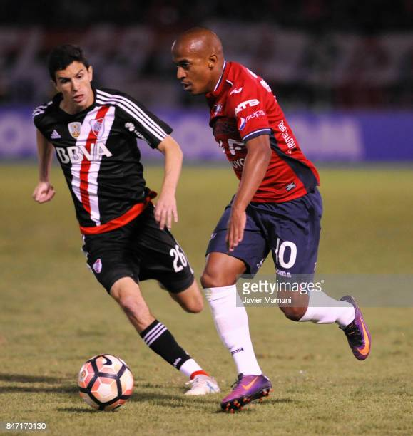 Serginho of Wilstermann and Ignacio Fernandez of River Plate compete for the ball during a first leg match between Wilstermann and River Plate as...