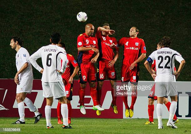 Serginho van Dijk Daniel Bowles and Jonathan McKain of Adelaide fight for the ball during the AFC Champions League Quarter Final match between FC...