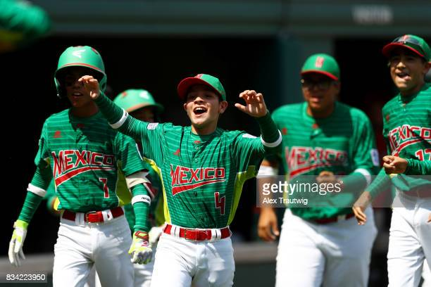 Sergio Adame of Team Mexico from Reynosa Mexico celebrates a home run by Andre Garza during Game 1 of the 2017 Little League World Series against...