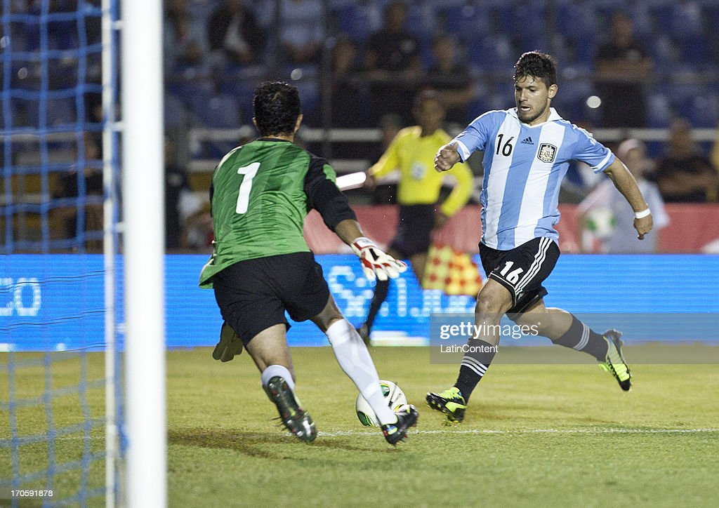 Sergio Agüero (R) of Argentina competes for the ball with Ricardo Jerez of Guatemala during a friendly soccer match between Argentina and Guatemala at Mateo Flores stadium on June 14 in Guatemala City, Guatemala.