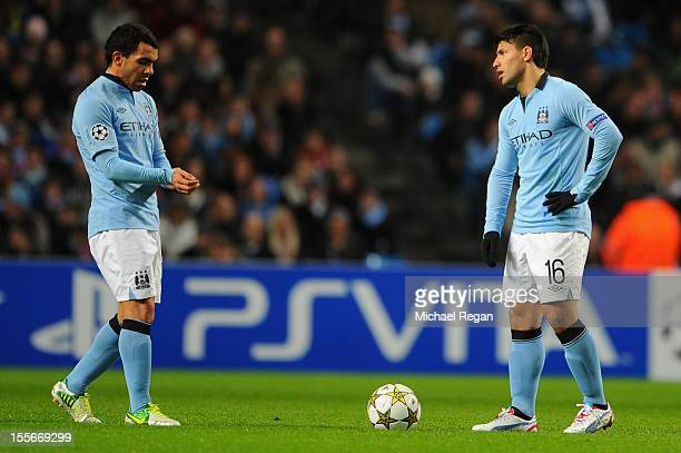 Sergio Aguero and Carlos Tevez of Manchester City react after his team conceded the second goal during the UEFA Champions League Group D match...