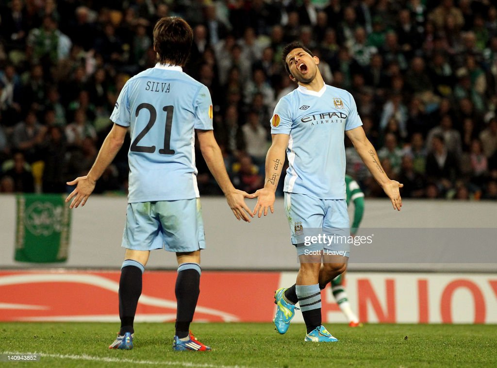 Sergio Aguero (R) and David Silva of Manchester City look dejected during the UEFA Europa League Round of 16 between Manchester City and Sporting Lisbon at Estadio Jose Alvalade on March 8, 2012 in Lisbon, Portugal.