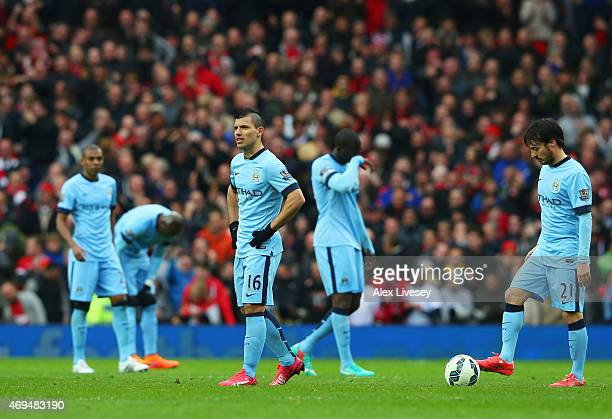 Sergio Aguero and David Silva of Manchester City look dejected alongside team mates during the Barclays Premier League match between Manchester...
