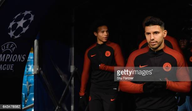 Sergio Aguero and Leroy Sane of Manchester City walk onto the pitch prior to the UEFA Champions League Round of 16 first leg match between Manchester...