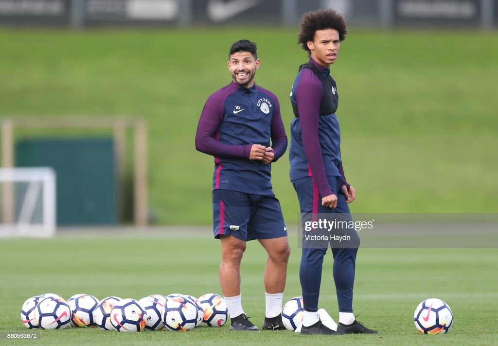 Sergio Aguero and Leroy Sane react during training at Manchester City Football Academy on October 12, 2017 in Manchester, England.