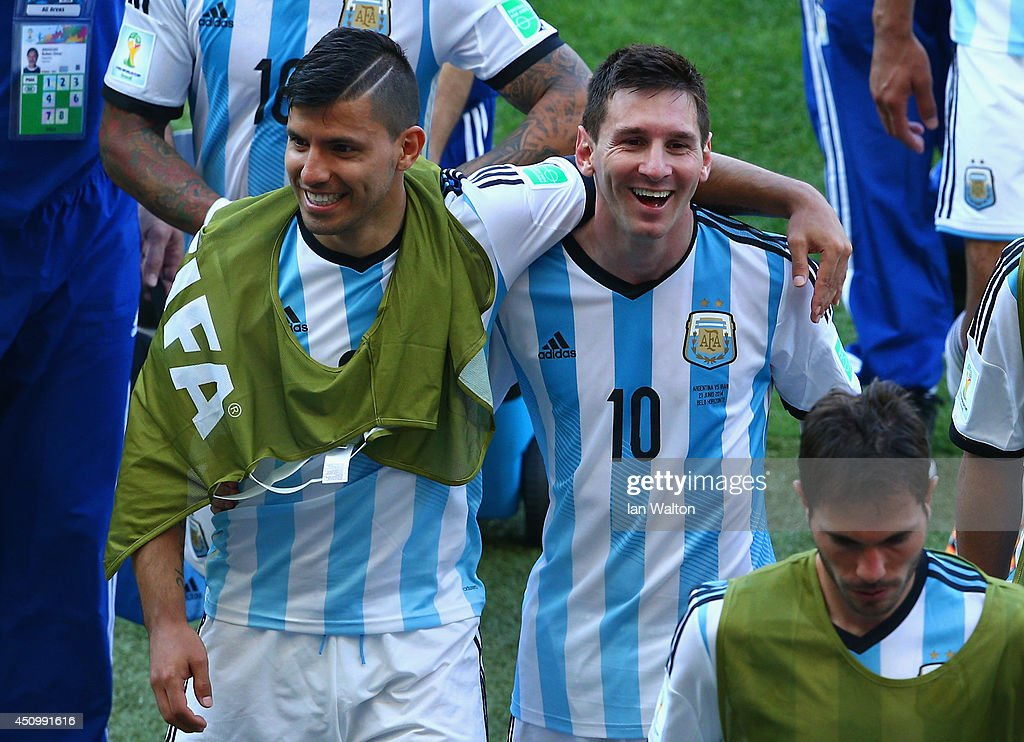 Sergio Aguero and Lionel Messi of Argentina react while walking off the field after defeating Iran 10 during the 2014 FIFA World Cup Brazil Group F...