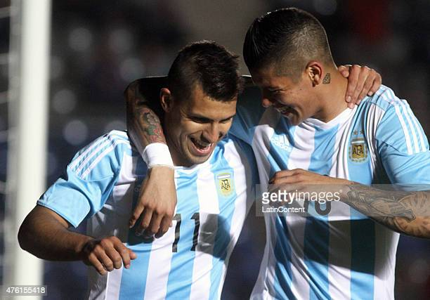 Sergio Aguero and Marcos Rojo of Argentina celebrate a scored goal during a friendly match between Argentina and Bolivia at Bicentenario de la ciudad...