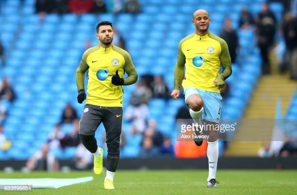Sergio Aguero and Vincent Kompany of Manchester City warm up prior to the Premier League match between Manchester City and Swansea City at Etihad...