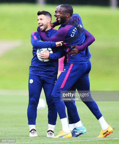Sergio Aguero Eliaquim Mangala and Yaya Toure group together during training at Manchester City Football Academy on September 11 2017 in Manchester...
