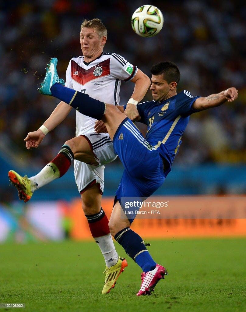 <a gi-track='captionPersonalityLinkClicked' href=/galleries/search?phrase=Sergio+Aguero&family=editorial&specificpeople=1100704 ng-click='$event.stopPropagation()'>Sergio Aguero</a> of Argentina and <a gi-track='captionPersonalityLinkClicked' href=/galleries/search?phrase=Bastian+Schweinsteiger&family=editorial&specificpeople=203122 ng-click='$event.stopPropagation()'>Bastian Schweinsteiger</a> of Germany compete for the ball during the 2014 FIFA World Cup Brazil Final match between Germany and Argentina at Maracana on July 13, 2014 in Rio de Janeiro, Brazil.
